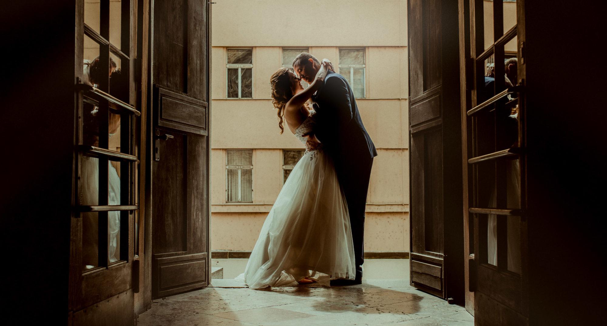 Prague-wedding-couple-in-a-church-hugging